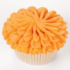 How to create a buttercream Tri-Level Rosebud on a Cupcake. This fantasy flower covers your cupcakes with amazing texture. Build petals in groups of three vertical petals to create an elongated multi-layered blossom.