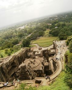 #TemplesofIndia, WONDERS OF ANCIENT INDIA: The awe inspiring Kailash / Kailasa Temple, Ellora Caves, Nr Aurangabad, Maharashtra. (Carved out from a single 120 feet high rock! in the 8th century AD, dedicated to Lords Shiva & Parvati) by www.TopUpYourTrip.com