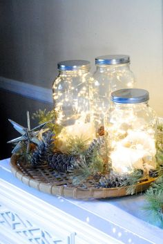 Our favorite country staple gets the holiday treatment in this DIY project: Simply fill a Mason jar with a bunch of string lights, then cluster together on a mantel or entryway table.