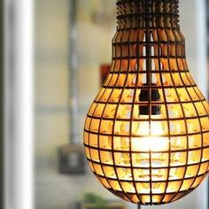 Laser Cut Wooden Bulb. The familiar shape of this lamp reminds us of Adam Kalkin's Bunny Lane design as the larger light bulb houses an actual light bulb. Made of laser cut wood, it emanates a waffle-like glow and adds a dimension of eccentricity to any space. $200.00