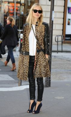 Cutout shoes and the black Leather sleeved printed trenchcoat ! Great look