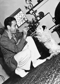 Humphrey Bogart and his dog, They apparently liked Terriers a lot -- I've seen photos of him and Lauren Bacall with Westies, Scotties, and now what looks like a Sealyham? Old Hollywood, Classic Hollywood, Hollywood Glamour, Celebrity Dogs, Celebrity Style, Bogie And Bacall, Sealyham Terrier, Actors Male, Humphrey Bogart