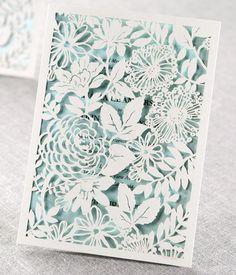 gorgeous laser-cut details in this wedding invite