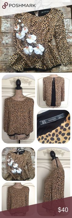 ZARA Leopard Print Blouse Super cute & stylish ZARA Trafaluc leopard blouse. It's a double blouse, with a black sleeveless blouse underneath a leopard 3/4 sleeve blouse. Open back detail with black blouse showing with tie. Soft viscose material, in good clean condition only worn a couple of times. Made in Morocco. 🎈No holds/trades 🎈No transactions outside Poshmark 🎈No lowball offers, open to reasonable ones 🎈Please use Offer button to negotiate Zara Tops Blouses