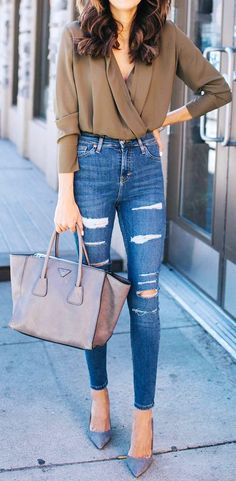 #winter #outfits brown surplice long-sleeved top, blue denim fitted jeans, and pair of gray heeled shoes outfit