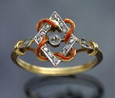 LOVERS KNOT  Belle Epoque Ring   Gold Enamel Diamond  H: 1.2 cm (0.47 in)   Marks: Eagle's head  French, c.1880  Ring Case  Enamel ribbon entwining a diamond lozenge with 15 rose cut diamonds  Minor enamel repair    Ref: 6915