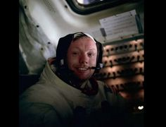 Neil Armstrong beams after taking the historic first steps on the moon