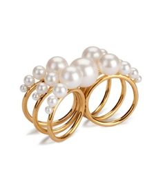 This 2 finger ring has got so many elements. Made up of 6 18ct gold bands then decorated with pearls graduating down each band, this is a very statement ring. Perfect for a night out!