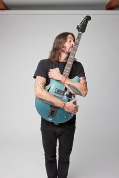 Dave Grohl & his Pelham Blue Gibson Trini Lopez...so nice :) I just want one (or the other, or both ;) )