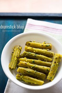 healthy drumstick bhaji recipe - a steamed and dry preparation of drumsticks with spices and coconut. #drumsticks