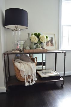One Story Building - living rooms - Crate & Barrel Manning Lamp, Home Decorators Industrial Louis Console, West Elm Large Curved Basket, Wes...