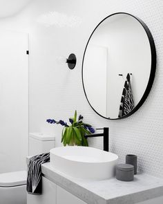 Adding a variety of textures to this white bathroom is what makes our Caulfield renovation beautifully unique.