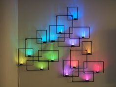 Beautiful LED wall sconces display weather and lighting effects, with an innovative, wireless, tangible user interface.
