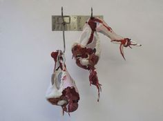 Festering, Actus Reus Series. Discarded Clothing and Metal Hooks. 43 x 30 x 18 inches, 2010.