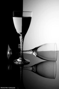 Abdullah Ather says this is a black and white still life shot of glasses he has taken. This is a refractive wine glass photo. Photo courtesy of Photography Tips