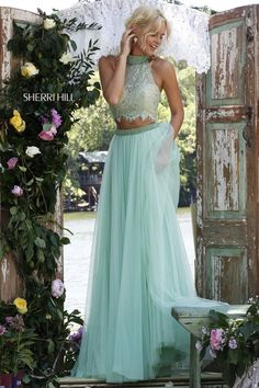 Sherri Hill Prom Spring 2016 # 32347 www.thecastlepromandbridal.com Colors: light green/nude, black/nude, ivory/nude, light blue/nude, lilac/nude, pink/nude