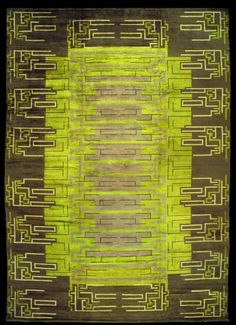 An French Deco carpet BB3028    Circa: 1920     A modern early 20th century French Art deco rug, the yellow green field with an elongated light gray center with angular dark gray lines overall within a broad dark gray field with similar ivory and green lines and geometric shapes.
