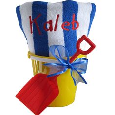 Love this beach towel gift buy really thin towels dry faster fill with beach toys and snacks sunglasses beach ball or inner tubes squirt toys and give em out to each child start of party