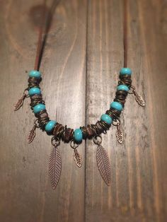 Bohemian turquoise and feather necklace by TribalChicBoutique