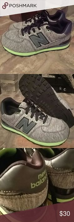 Boys New Balance 574 Neon green and a black/white canvas New Balance 574. Hardly worn. Size 5. Do not have box. New Balance Shoes Sneakers