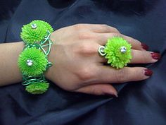 Floral Rings. Make a fun statement by wearing a ring embellished with a cute button mum.