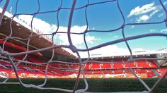 A view from inside the goal at Old Trafford, home of @manutd.
