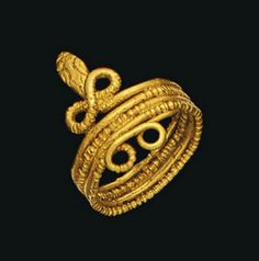 A ROMAN GOLD SNAKE RING   CIRCA 1ST CENTURY B.C.-1ST CENTURY A.D.   The body formed of coiled alternating plain and beaded wire, the neck twisted into a figure-of-eight, the tail coiled into two spiral loops, details on the head delineated  7/8 in. (2.2 cm.) long