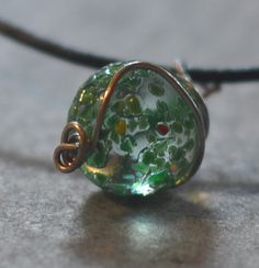 Green Marble Necklace  Wire Wrapped in Handmade wire cage. Packaged in handmade felt pouch featuring recycled button $14.50