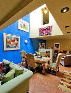 Mexican Interior Open Space Dining Room With Painting Wall Arts Colorful And Charming Mexican Interior Design Check more at http://www.wearefound.com/colorful-and-charming-mexican-interior-design/