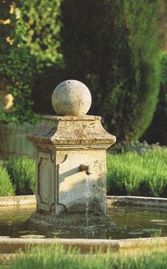 plinth and ball make a nice focal point in garden
