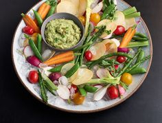 Seamus' cleaned-up answer to chips and guac, this crunchy veg and creamy, slightly-spicy dip combo is our new summer favorite.