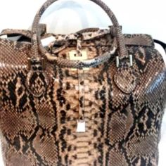 Micheal kors python handbag new with tags This is a brand-new Michael Coors python him back which is absolutely gorgeous full price with tax 2795 Michael Kors Bags