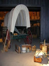 A wagon in process of being loaded with supplies for the trek west on display in the interpretive area within the The National Oregon/California Trail Center. Pioneer Day, Pioneer Life, Westward Expansion, Covered Wagon, Oregon Trail, Lewis And Clark, Mountain Man, California, Horse Drawn