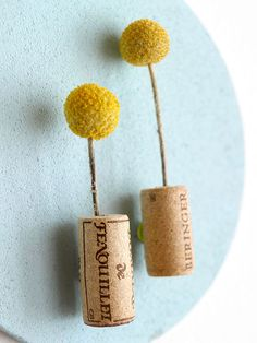Cork Pushpins-Drill into the top of a wine cork (don't drill through the entire cork, though) to create a vessel. Use permanent glue to adhere a pushpin to the cork. Insert a dried flower or feather into the drilled hole and display on a bulletin board for fresh flair.