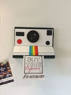 Marketing idea for yearbook class. We then made small polaroid camera around the… Marketing idea for yearbook class. We then made small polaroid camera around the school kids could pull an ad from. Yearbook Shirts, Yearbook Staff, Yearbook Pages, Yearbook Spreads, Yearbook Covers, Yearbook Layouts, Yearbook Design, Yearbook Theme, Cool Yearbook Ideas