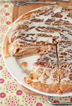 Upside Down Apple Pie Recipe ~ Thinly sliced apples encased between two layers of flaky crust topped with caramel walnuts and a sweet glaze. It tastes like apple pie meets streusel cake.