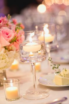 Floating Candles in Clear Glass Vases. Romantic candles and wedding ideas, get inspired at www.scentedcandleshop.com.