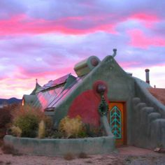 Earthship home.100% off-the-grid, recycled materials. Generates it's own power…