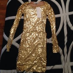 La Quan Smith gold mini dress! The dress is a gold mini by La Quan Smith. The texture when worn is shown in picture #3 and picture #4 . It is new never worn with tags La Quan Smith  Dresses Mini