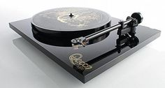 Rega was approached by the legendary rock band Queen to produce a limited-edition turntable to coincide with the recent release of Queen: The Studio Collection, an 18-piece box set from Virgin EMI Records ($445) featuring 180g colored vinyl LPs.