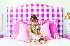 Little girl's vibrant and patterned headboard and pillows