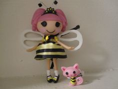 I customized this mini Lalaloopsy doll for a friend who likes bees.  The dress is made from yellow and black ribbon that is hand sewn, the wings are made from a foam sheet, she is hand painted, her pet too.  the antenna is made from wire and Swarovski crystals.