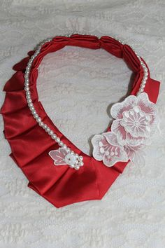 ** Red 100% silk, Glass pearls and vintage lace embroidery, snap closure, not adjustable**  Silk Necktie Necklace Unique Accessories / Collars are all handmade and one of a kind pieces. These unique, one of a kind Necklaces are made from up-cycled/used/re-purposed mens silk neckties.  Neckties are all 100% silk and are chosen very carefully by quality of the fabric, color and pattern. (Most ties are Italian imported silk). These necklaces are all unique and there are no two nec...