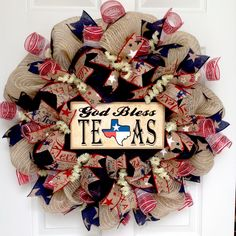 "God Bless Texas Home Welcome Wreath Handmade Deco Mesh. Full! New! Premium! Handmade All Season Deco Mesh Door Wreath. A large, wood ""God Bless Texas"" sign rests on navy blue deco mesh. The sign is natural wood color and is decorated with a state outline decorated with the lone star state flag. The inner ring has burlap ribbons with red, white and blue stars along with canvas ribbons with the word Texas written in red and blue. The outer ring is made of beautiful burlap with ivory and..."