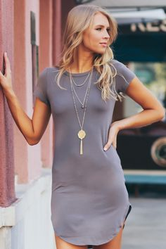 Short Sleeve Bodycon Dress Medium Grey. Rock this classic and solid bodycon dress with short sleeves, a crew neckline, and a scoop bottom hem.