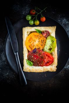 These Tomato Basil Tarts with White Bean Puree are a quick meat-free summer meal packed with protein-rich white beans and flavorful heirloom tomatoes and basil.