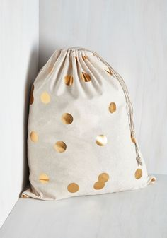 Pizzazz Good as Gold Laundry Bag. Make a stellar statement in your day-to-day routine with this cotton hamper! #gold #modcloth