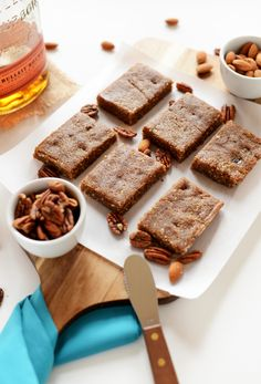"#paleo Boozy Raw Pecan Pie Bars with Sea Salt: 1½ cups raw almonds; 1½ cups raw pecans; 1 heaping cup pitted dates (10-12 large medjool dates); 2 pinches sea salt (about ¼ tsp); ½ tsp pure vanilla extract; SUBSTITUTE ⅓ cup unsweetened organic Apple Cider for bourbon, ADD ½ to 1 tsp Bourbon Extract, sugar and gluten free instead of ""Bulleit Frontier Bourbon Whiskey""; ½ cup raw almonds; ¾ cup raw pecans; pinch sea salt; ¼ tsp pure vanilla extract; 1 cup pitted dates (8-12 large medjool dates)"