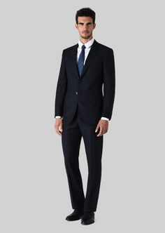 Fine materials and design for this WALL STREET WOOL SUIT  by Giorgio Armani  Men. Take a look at the official online store now. Giorgio Armani, Armani Men, Leg Cuffs, Tuxedo For Men, Mens Essentials, Wall Street, Wool Suit, Jacket Buttons, Classic Man