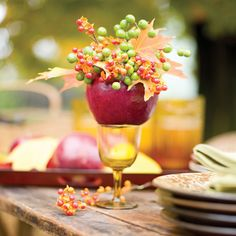 Apple decoration ideas. They're delicious but they're also beautiful and great when it comes to making table decorations.